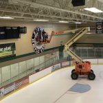 custom hockey rink signage installation